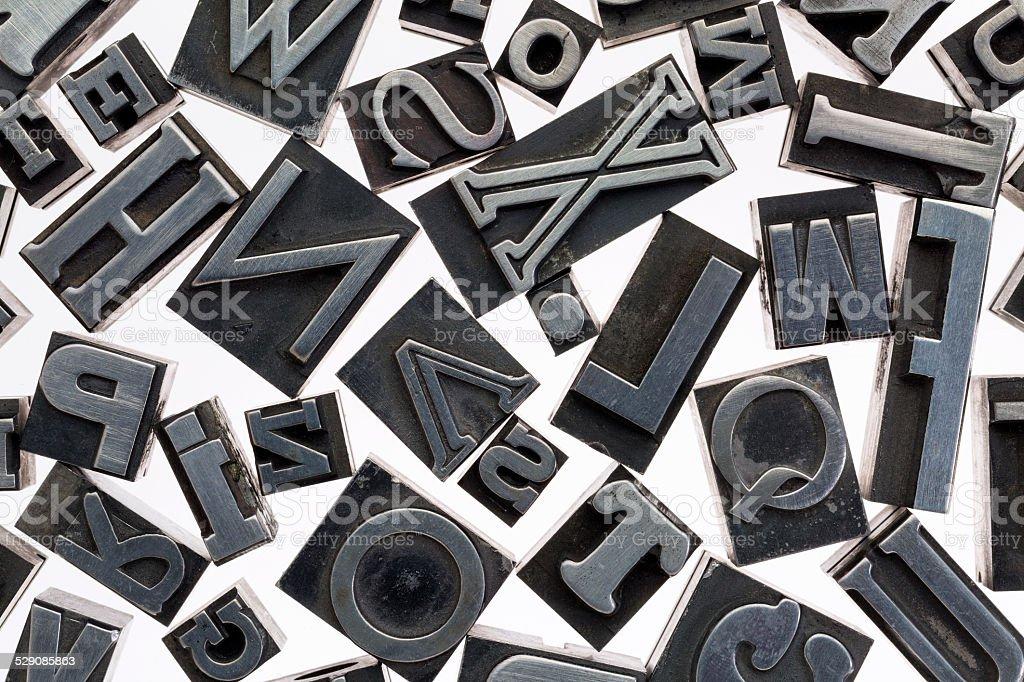 random letters in metal type stock photo