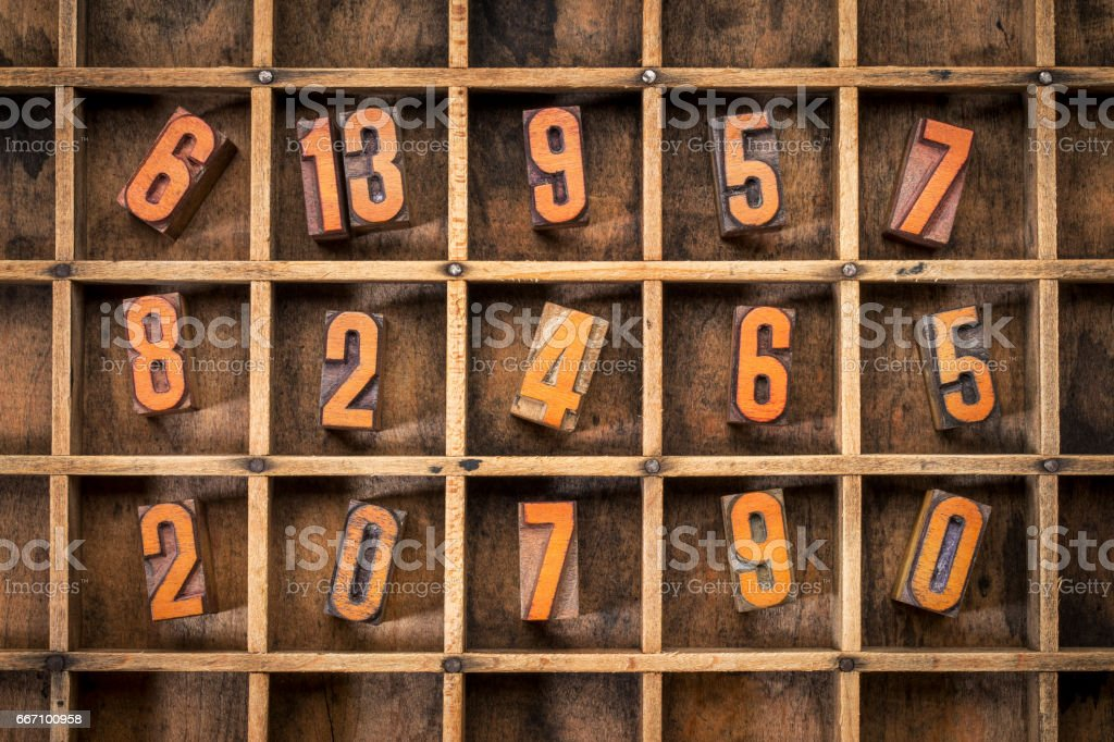 random number in typesetter box stock photo