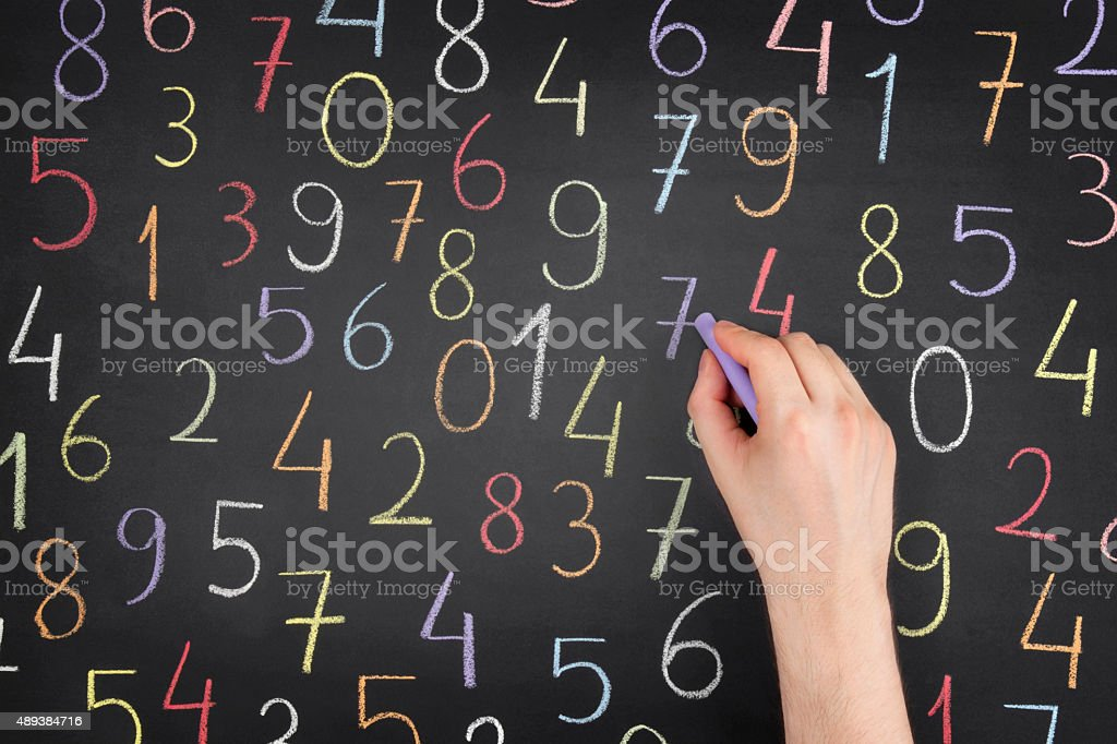 Random Numbers Over Blackboard stock photo