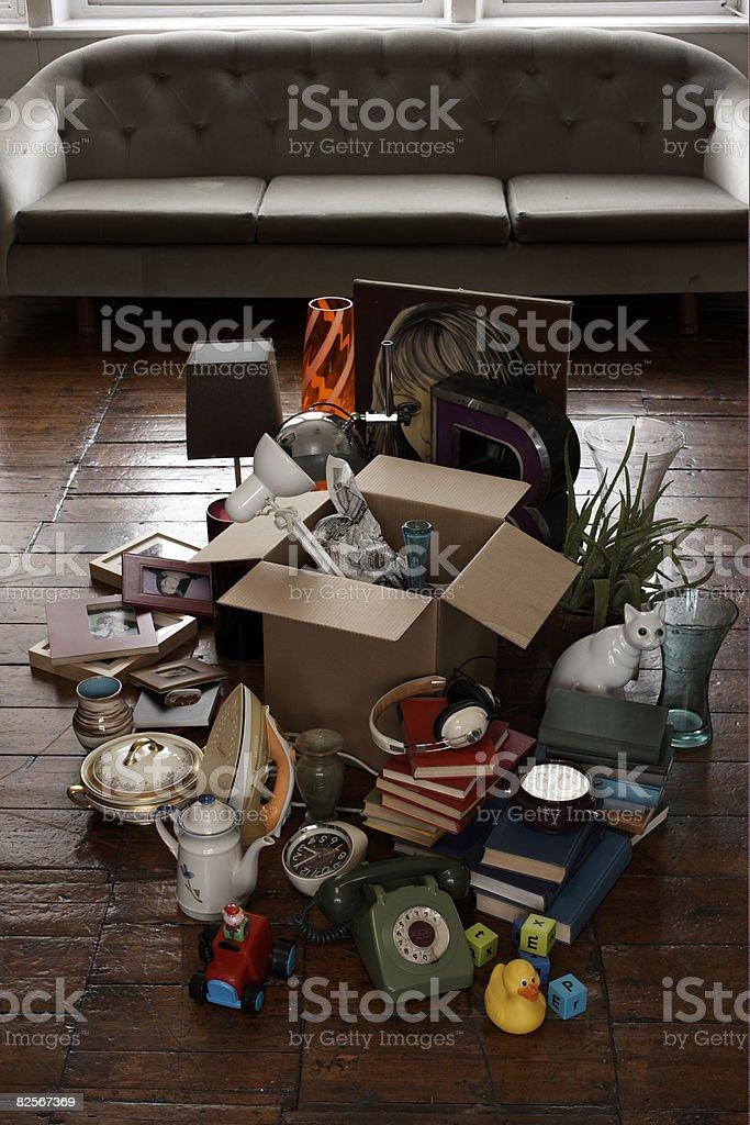 random objects on living room floor stock photo