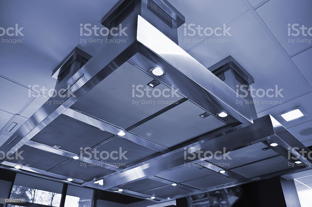 Range hood in the kitchen. Air ventilation system. stock photo