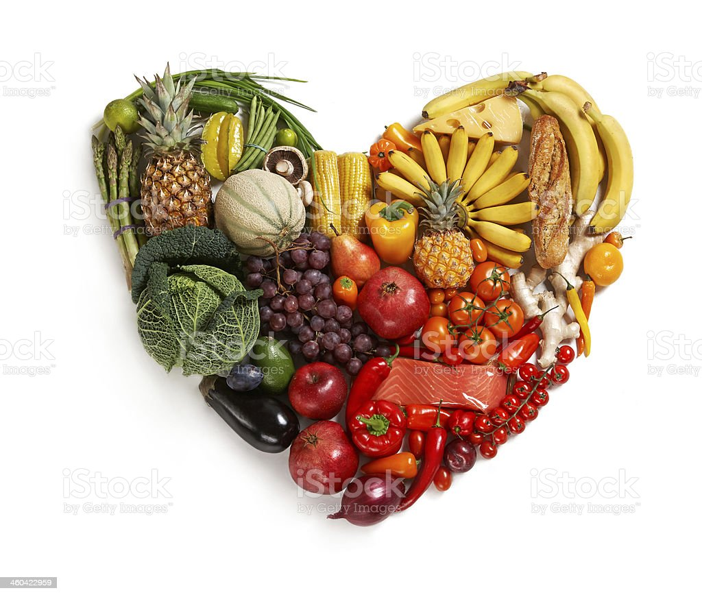 A range of fruit & vegetables in the shape of a heart stock photo