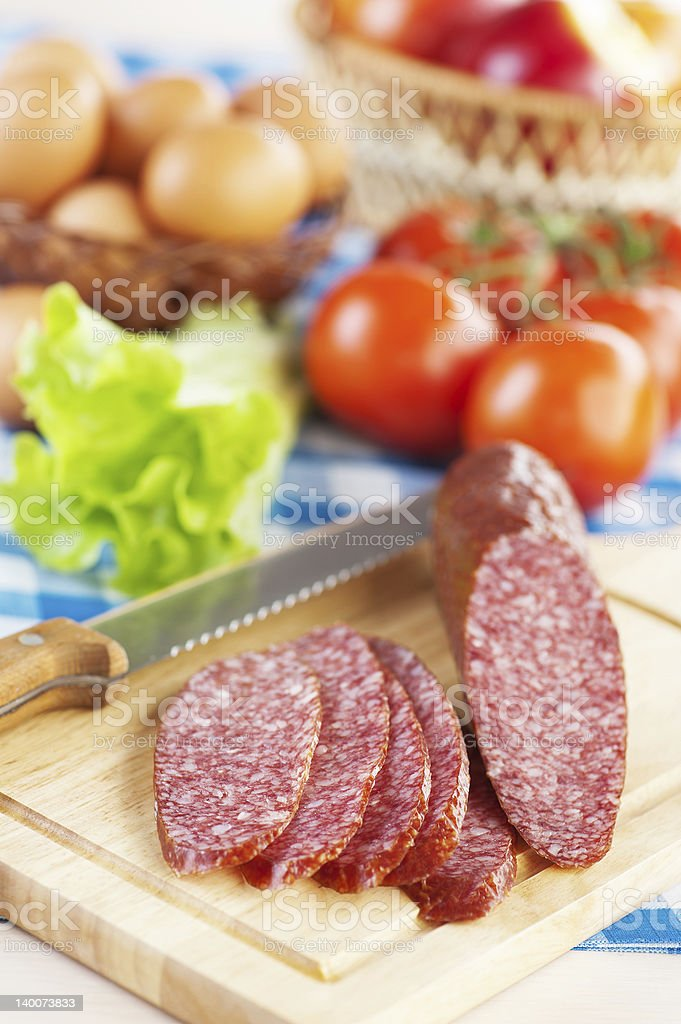 range products (sausage salami, lettuce, tomatoes, eggs, apples) royalty-free stock photo