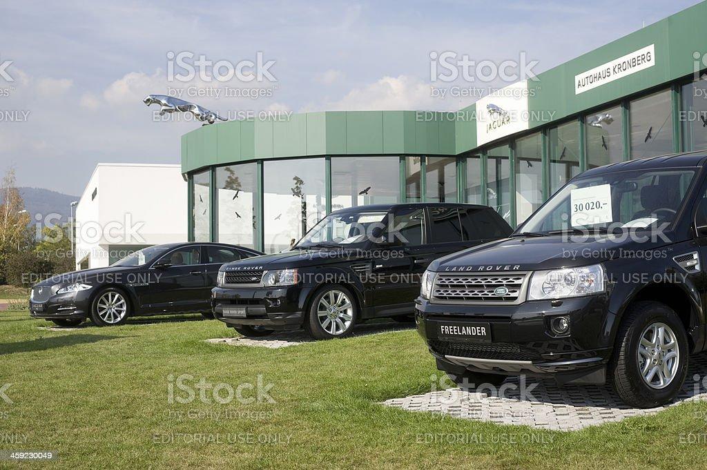 Range Rover and Jaguar outside a car retailer`s building stock photo