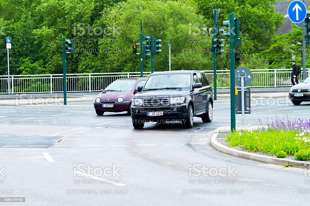 Range Rover passing junction stock photo