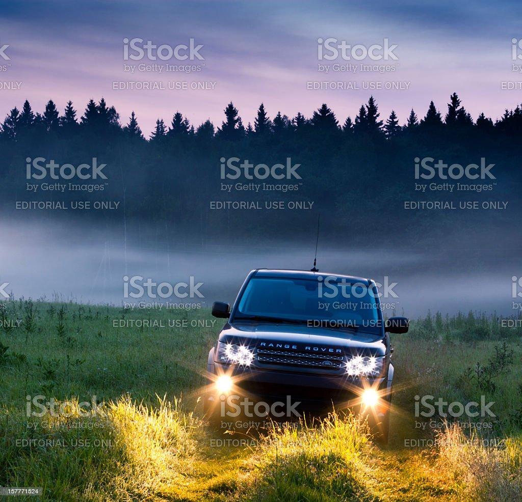 Range Rover Sport in misty morning stock photo