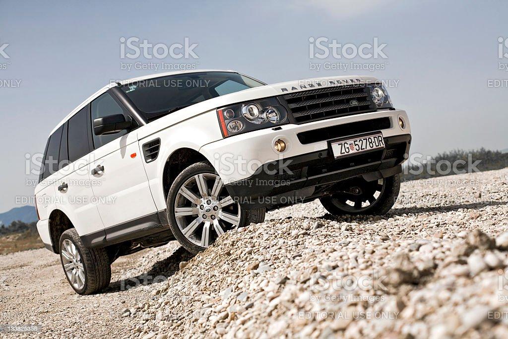Range Rover Sport over crest stock photo