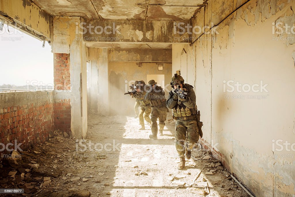 Rangers stormed the building occupied by the enemy stock photo