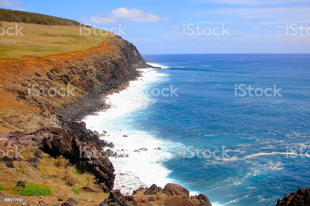 Rano Kau volcano -  Impressive Easter Island and dramatic coastline shore: blue waves splashing on the rocks formation cliffs - Rapa Nui ancient civilization -  Idyllic pacific ocean at dramatic sunset, dramatic landscape panorama – Chile stock photo