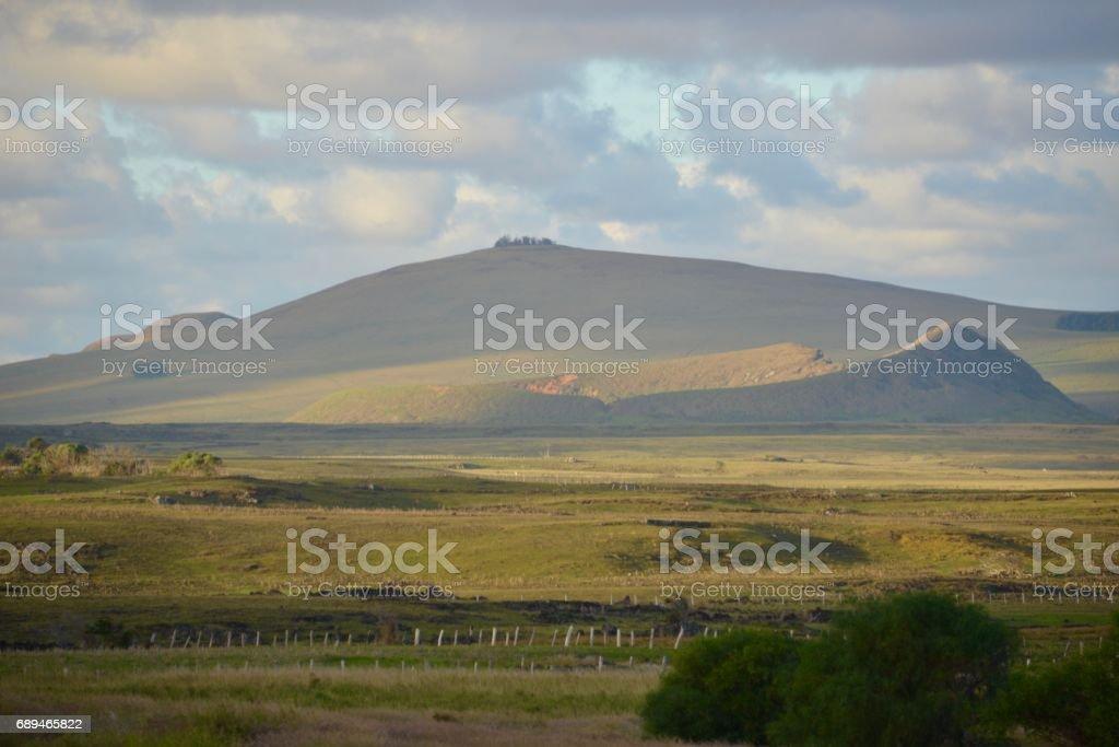 Rano Raraku volcano in the distance, Easter Island stock photo