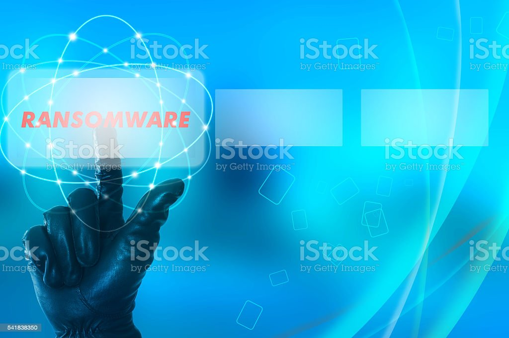 Ransomware concept with hand wearing black glove pressing red bu stock photo