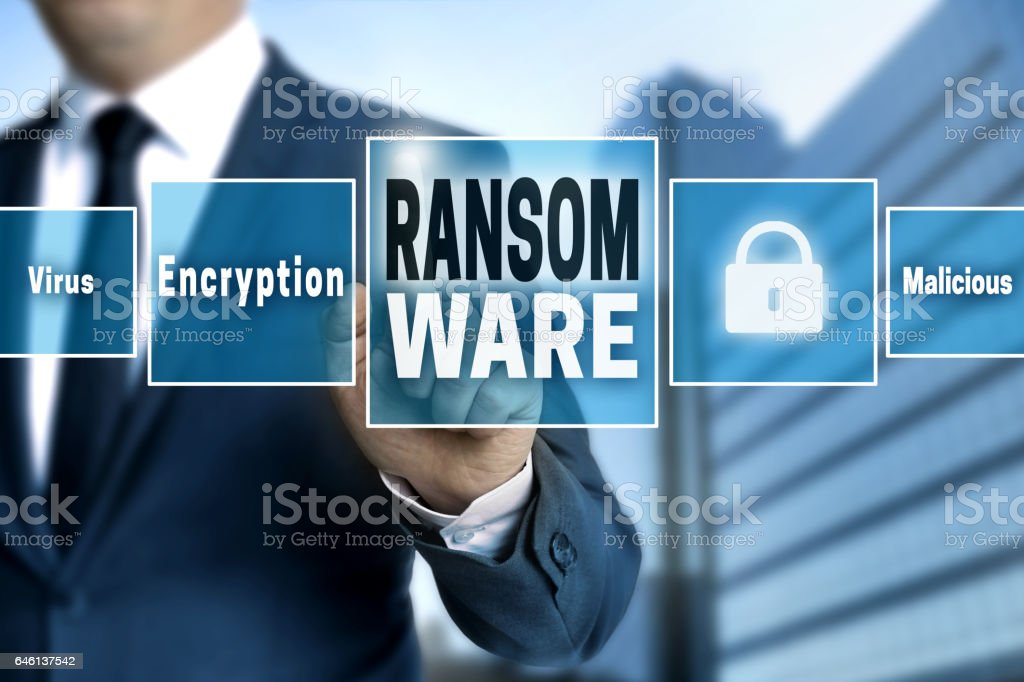 Ransomware touchscreen is operated by businessman stock photo