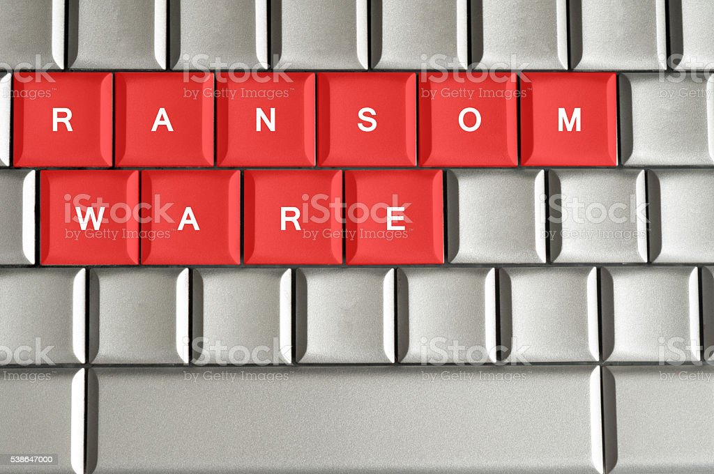 Ransomware written on metallic keyboard in red stock photo