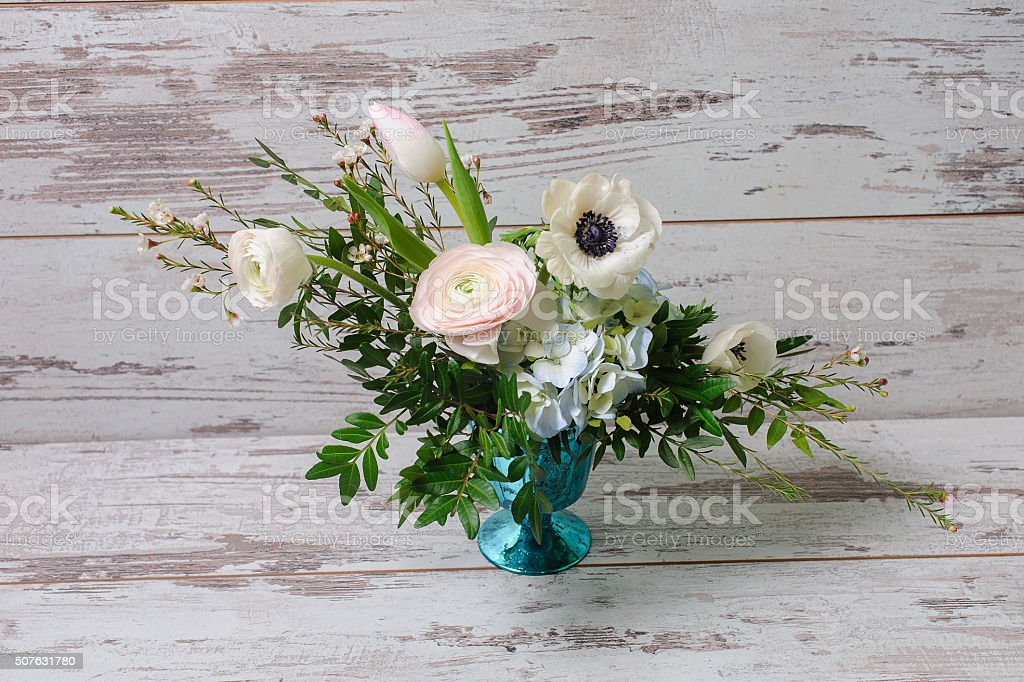 Ranunculus and the anemones in vase. stock photo