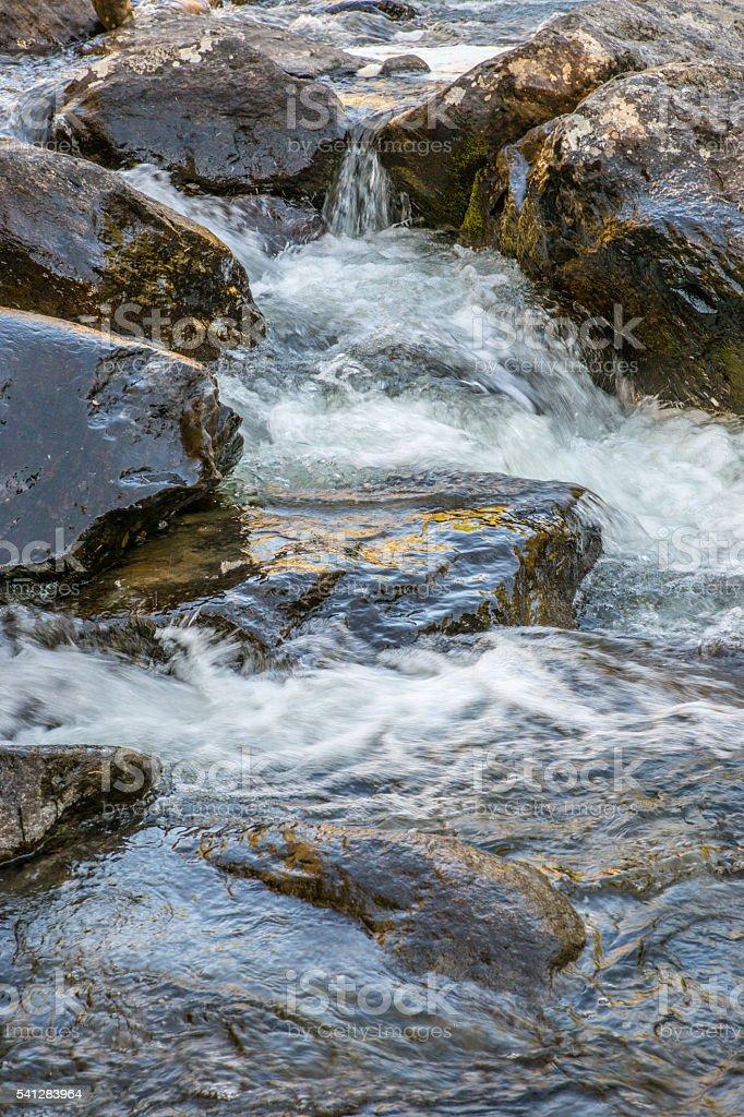 Rapid flow of the Chulcha river near Uchar waterfall stock photo