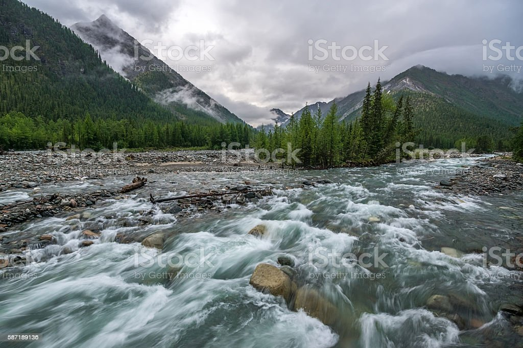 Rapid mountain river Shumak in tunka range stock photo