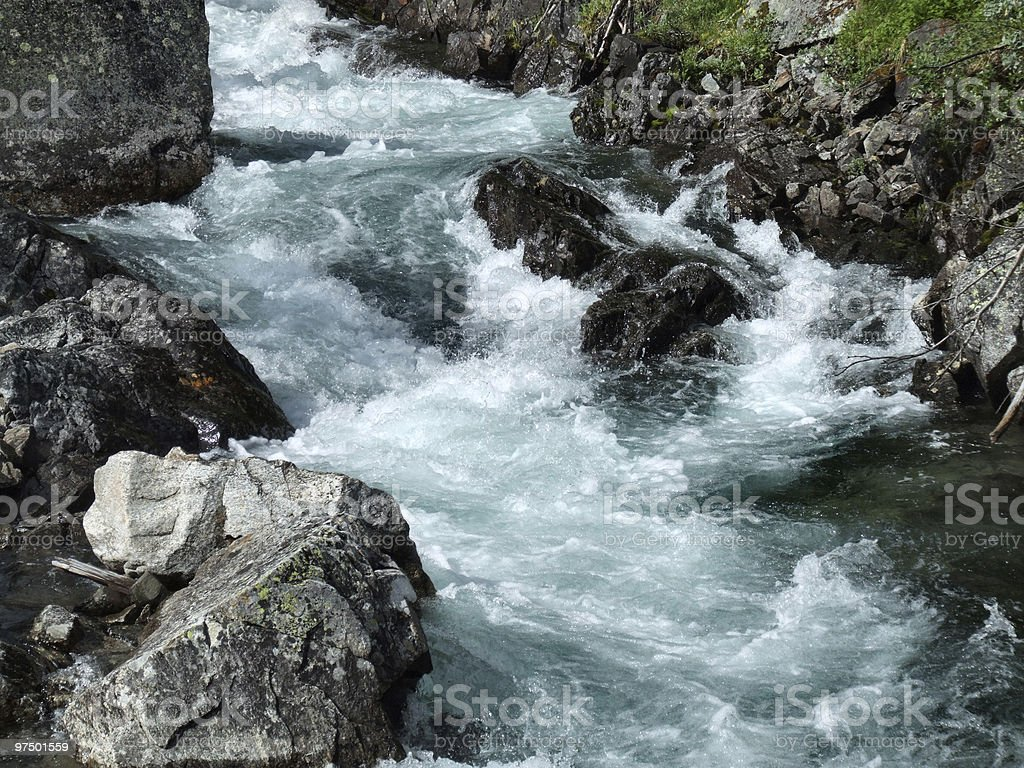 Rapid river in mountains stock photo