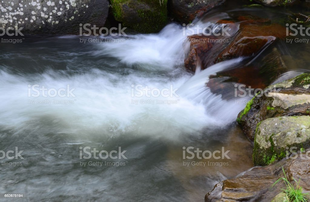 Rapid running water in a river stock photo