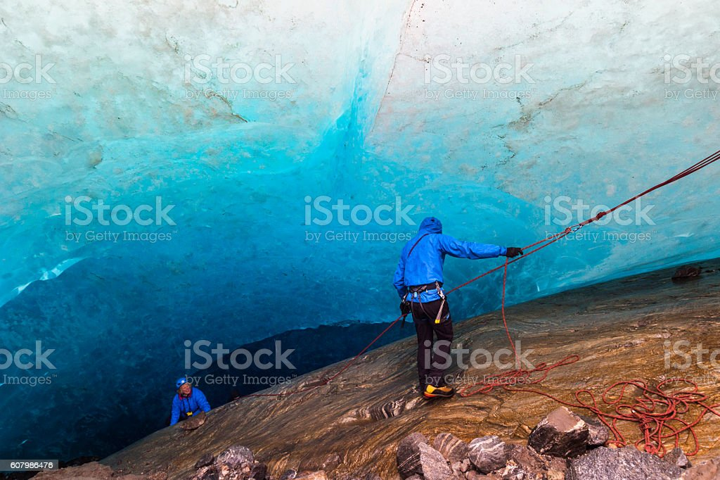 Rappelling into an ice cave stock photo