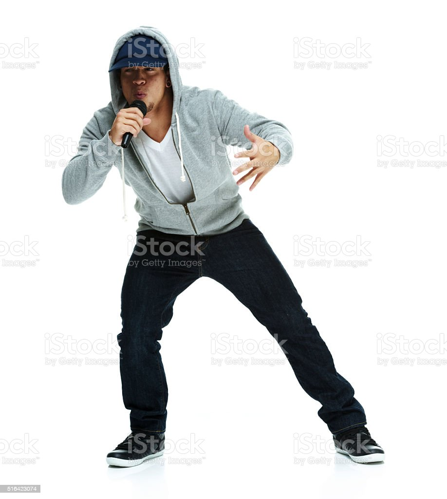 Rapper singing with microphone stock photo