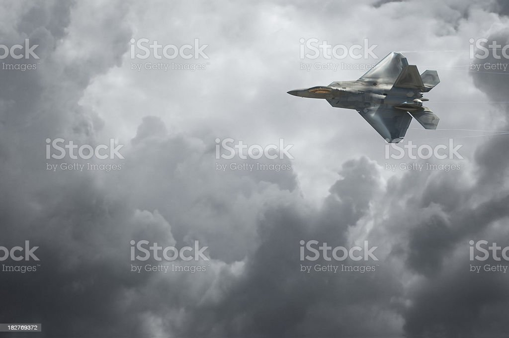 F-22 Raptor Against Dramatic Sky royalty-free stock photo