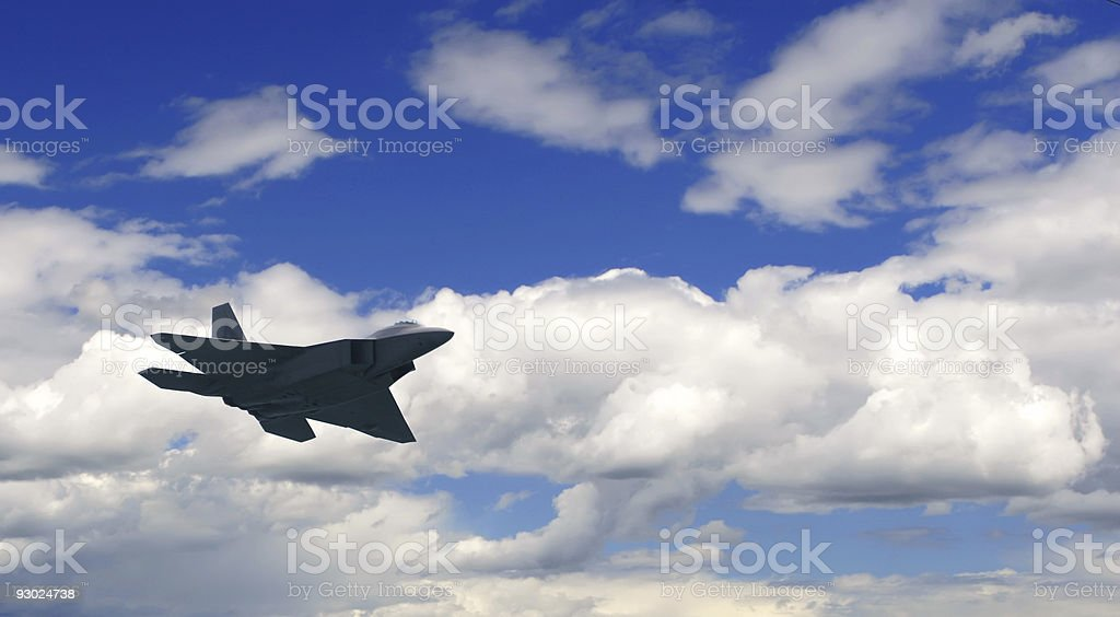 F22 raptor airborne on a lovely day stock photo
