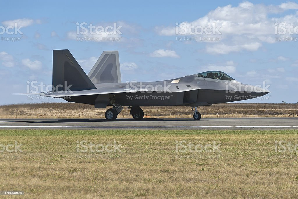 F-22 Raptor fighter bomber landing on runway. royalty-free stock photo
