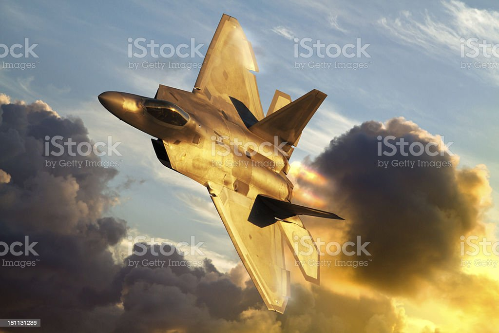 F-22 Raptor flying above clouds stock photo