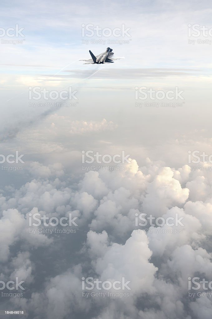 F22 Raptor Flying Above the Clouds stock photo