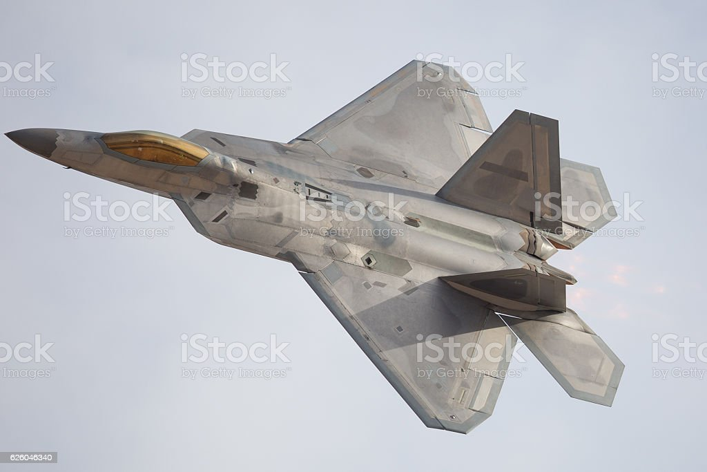 F-22 Raptor in a turn, with afterburner on stock photo