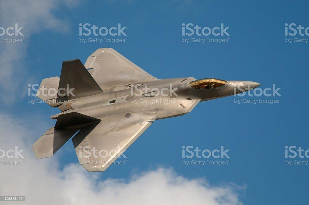 F22 Raptor Jet Fighter flying in the sky stock photo