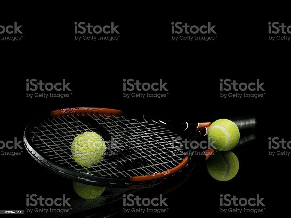 Raquet with tennis balls royalty-free stock photo