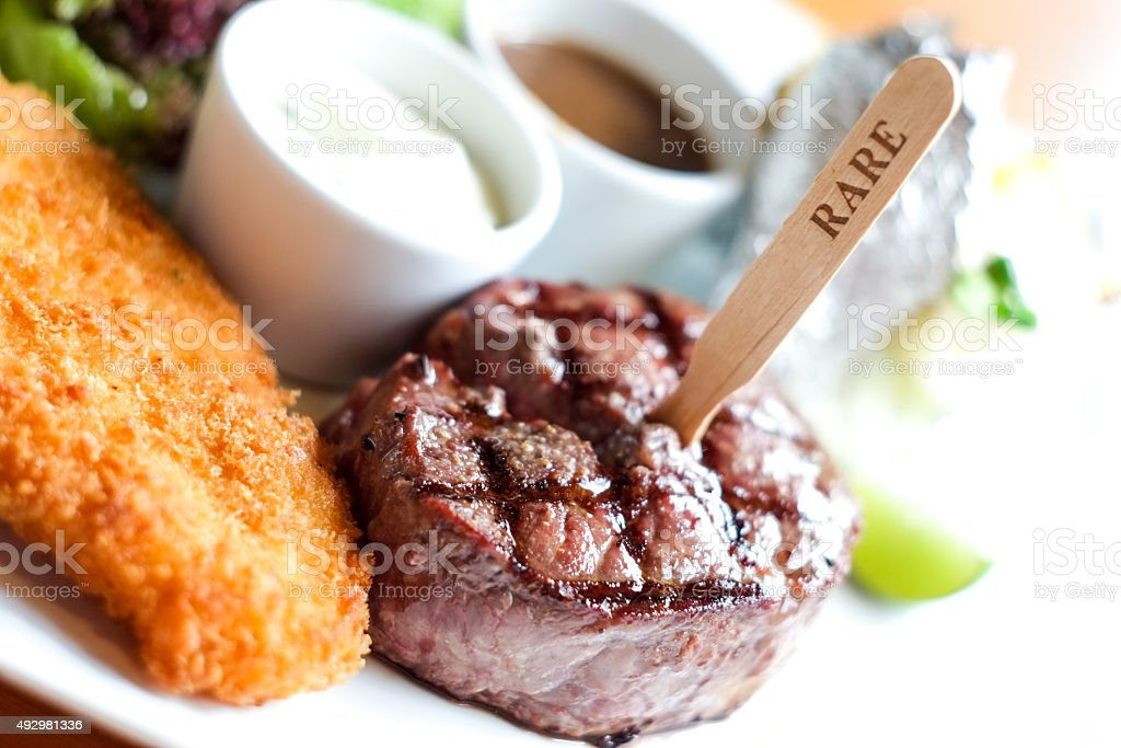 rare beef steak and fired fish stock photo