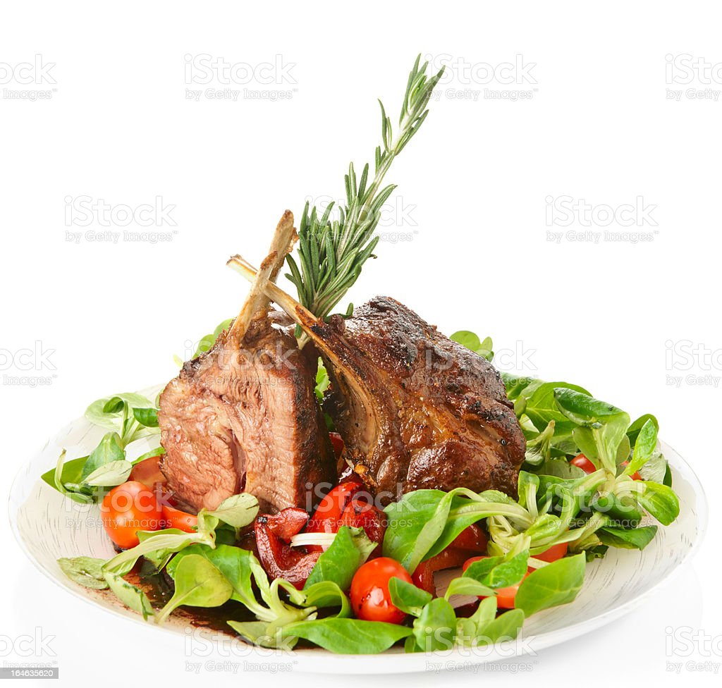 Rare fried rack of lamb isolated on white royalty-free stock photo