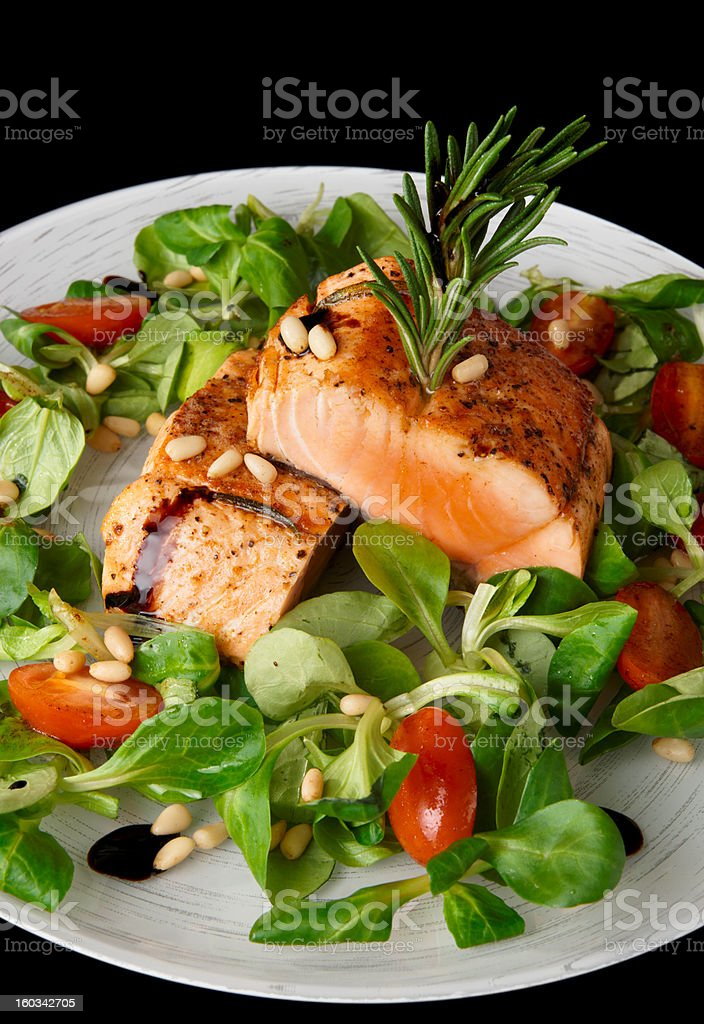 Rare fried salmon steaks isolated on black royalty-free stock photo