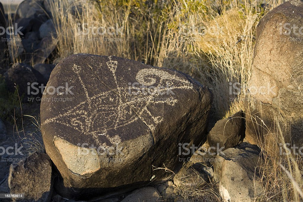 Rare Native American Hunting Bighorn Petroglyph near Alamogordo New Mexico royalty-free stock photo