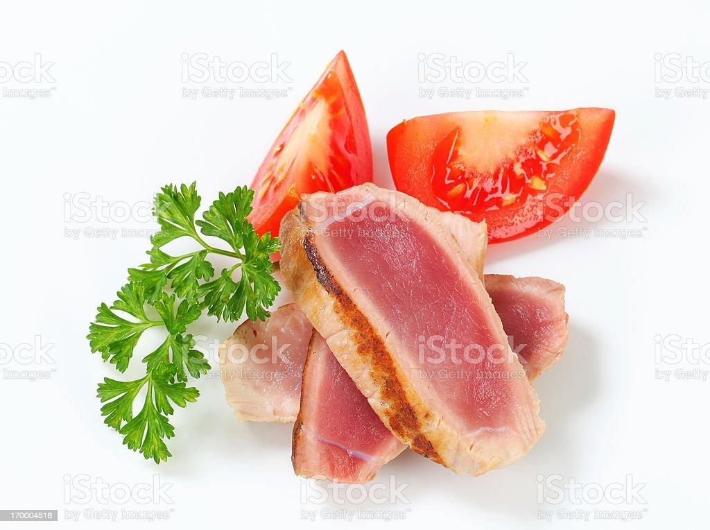 rare pork steak slices with vegetable decoration royalty-free stock photo