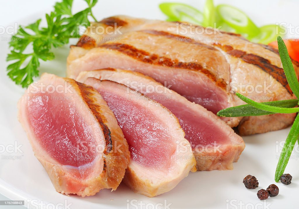rare pork steak with spices and herbs royalty-free stock photo