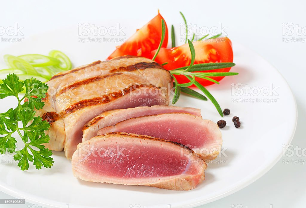 rare pork steak with tomatoes and herbs royalty-free stock photo