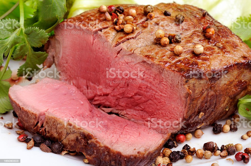 Rare steak with green salad on a white background royalty-free stock photo