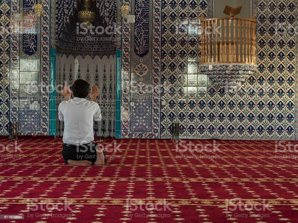 Rare View Of Muslim Man Praying Mosque stock photo