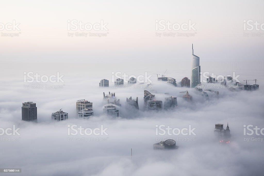 Rare winter morning fog blanketing Dubai skyscrapers. stock photo