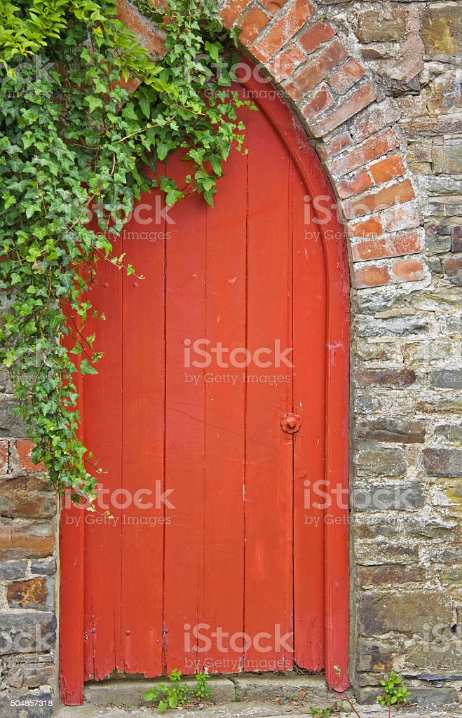 Rarely used old doorway to a walled English garden stock photo