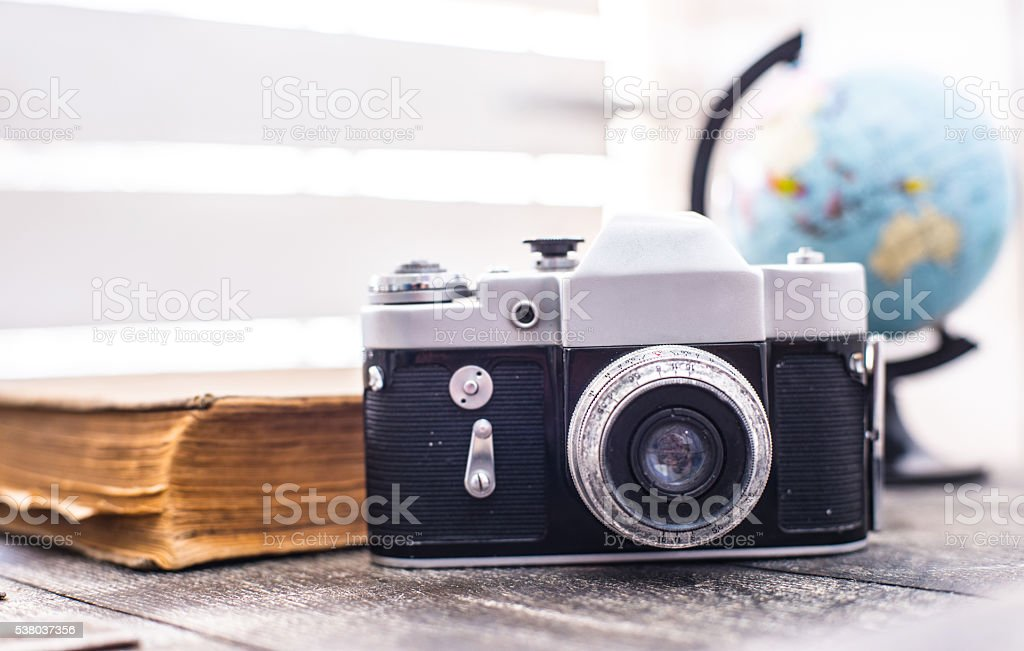 rarity camera zenit with globe on the background stock photo