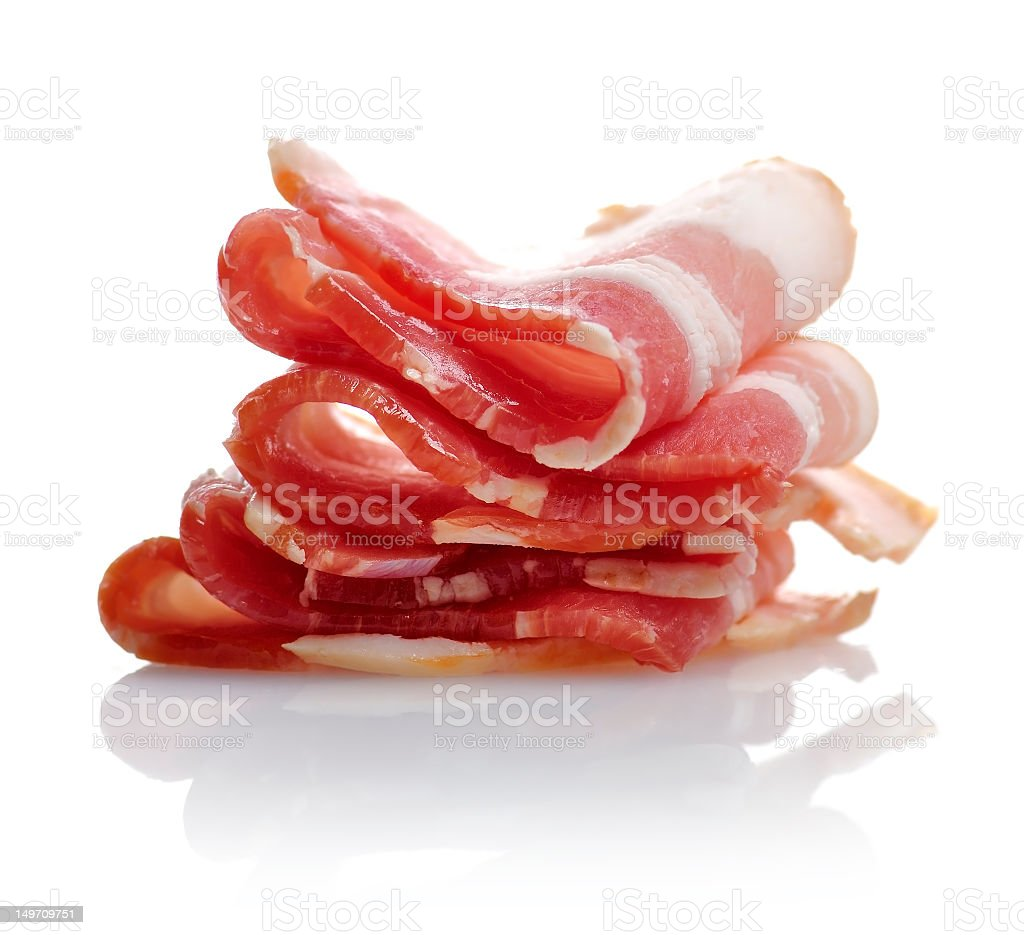 Rashers of sliced bacon on white stock photo