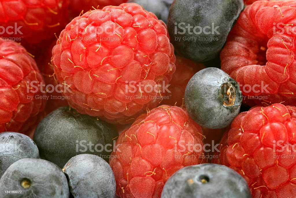 Raspberries and blueberries mixed together  royalty-free stock photo