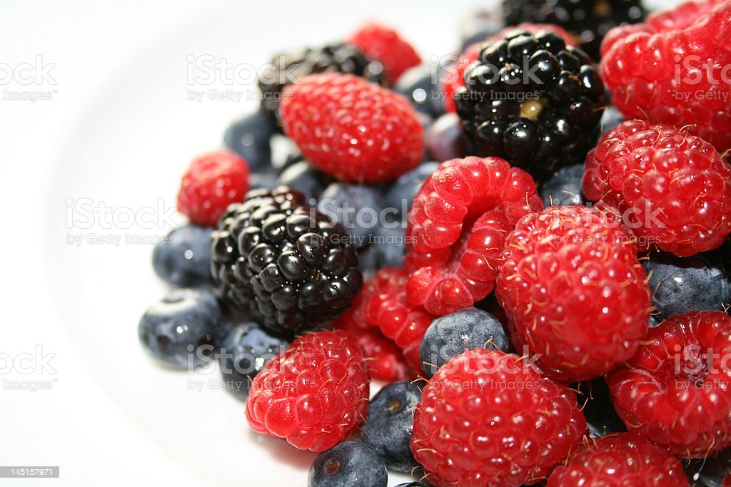 Raspberries and Blueberries royalty-free stock photo