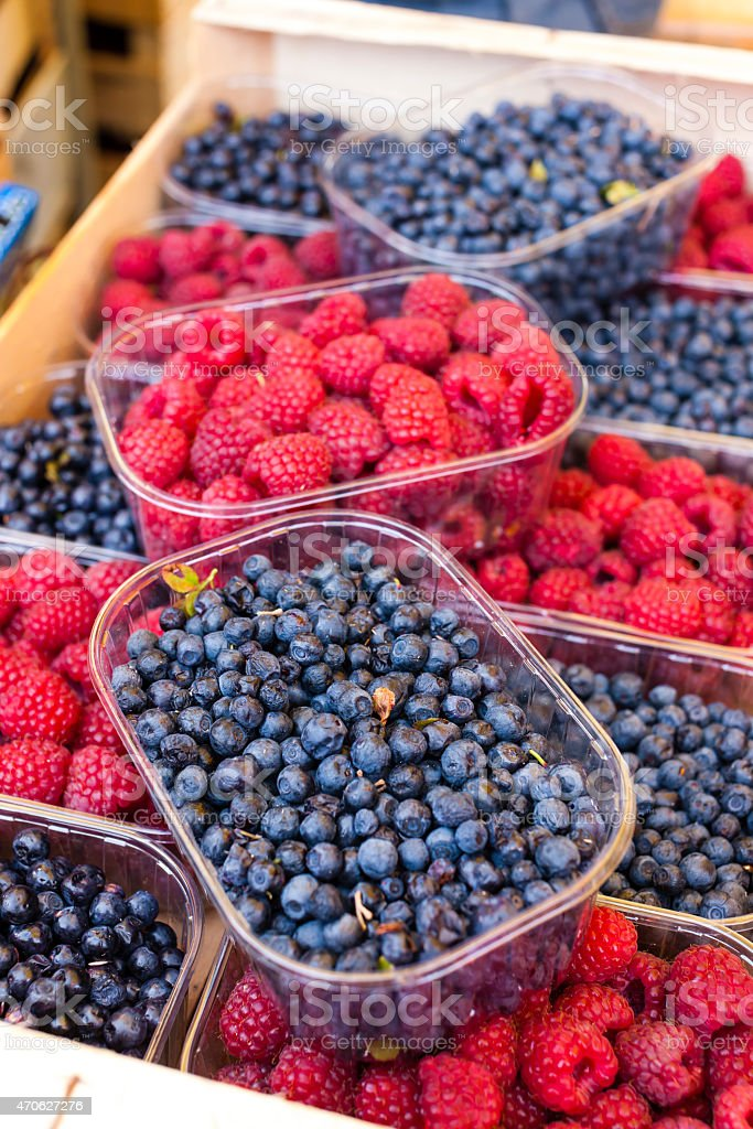raspberries and blueberries stock photo