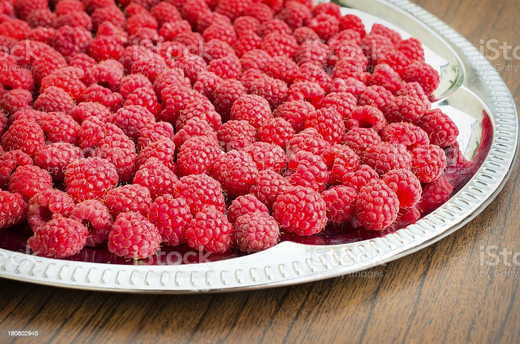 raspberries are on a metal tray royalty-free stock photo