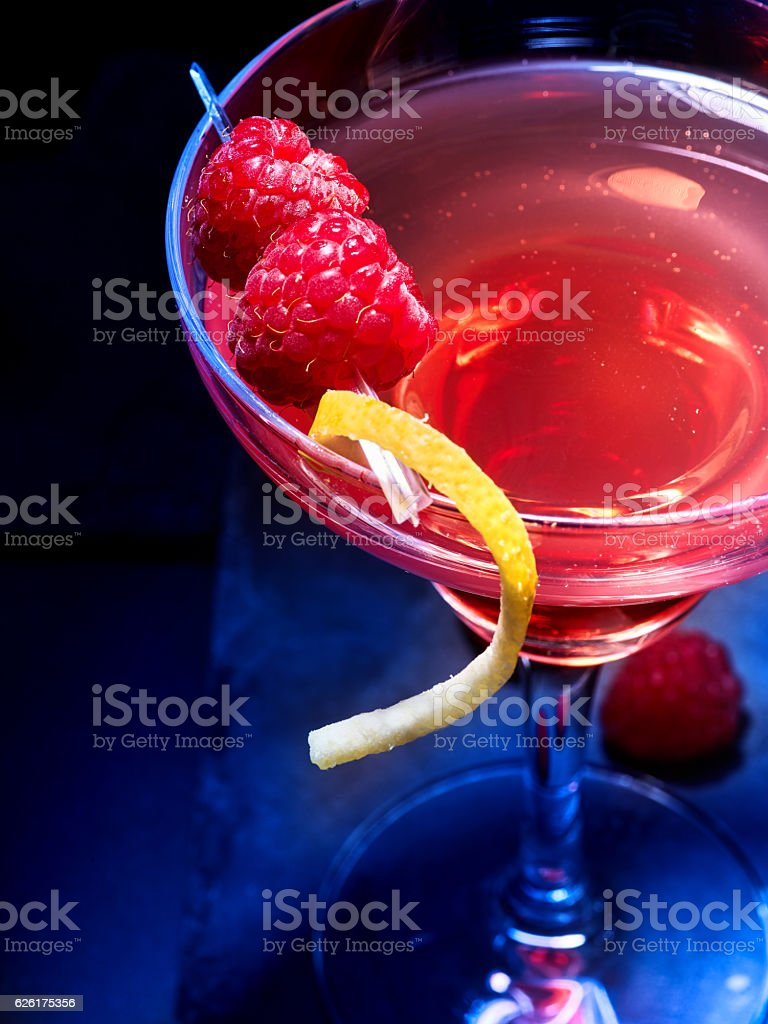 Raspberries cocktail on black background stock photo